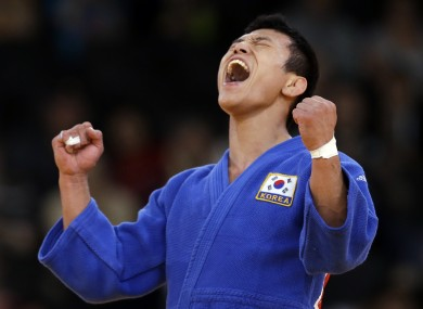 Jun-Ho Cho of South Korea celebrates but the winning decision would be reversed.
