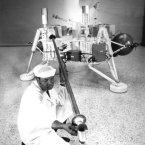 A technician checks soil sampler equipment on the Viking 1 Lander in 1971 ahead of its mission to Mars. (Image: NASA)