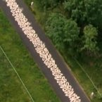 Zig zag road art - Acclaimed land artist, Richard Long, has created a road river on a road where the Olympic cyclists will cycle in Box Hill. (Via You/Tube/nationaltrustcharity)