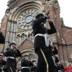 A loyalist band plays music outside St Patrick's Roman Catholic Church in Belfast. (AP Photo/Peter Morrison/PA)
