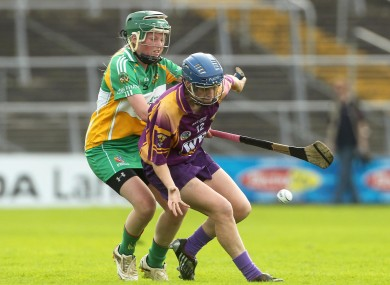 Wexford's Josie Dwyer holds off Triona McDonald of Offaly.