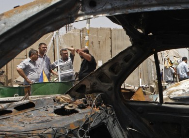 The scene of a car bomb explosion in Sadr City, Baghdad on 23 July.