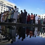 Muslim worshippers offer the Eid al-Fitr prayer at Lisbon's Martim Moniz square. (AP Photo/Francisco Seco/PA)