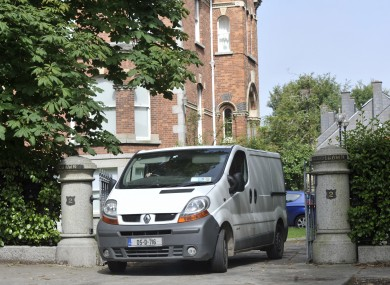 Personal items belonging to the McFeely family being removed from their house yesterday.