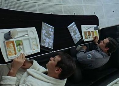 Computer tablets similar to the iPad being used in 2001: A Space Odyssey.