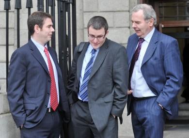Sean Quinn jnr, Peter Quinn and Sean Quinn snr (L to R) outside the High Court (File photo)