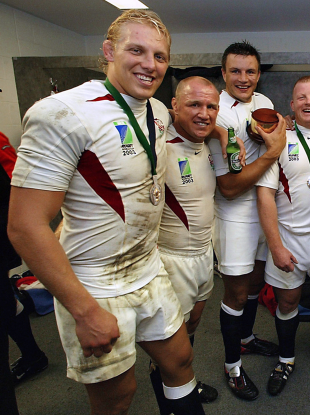 Lewis Moody celebrates with England teammates in 2003.