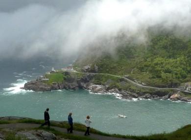 A fog blows into the harbor in St. John's, Newfoundland