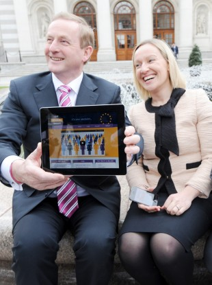 Enda Kenny and Lucinda Creighton launch a Fiscal Compact website using an iPad. Oireachtas plans to supply a tablet machine to every TD have been stalled over procurement technicalities.