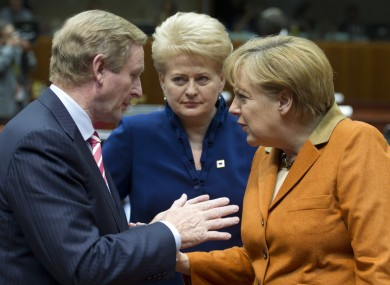 Lithuanian president Dalia Grybauskaite eavesdrops on a conversation between Enda Kenny and Angela Merkel at last week's European Council.