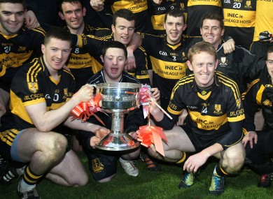 Dr Crokes Kieran O'Leary and Colm Cooper lift the trophy aloft.