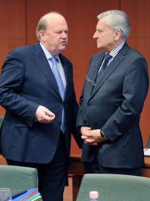 Michael Noonan speaks with Jean-Claude Trichet, the then-ECB president, at Noonan's meeting of European finance ministers in March 2011.