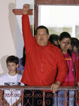 Chavez greets his supporters at the Miraflores presidential palace balcony in Caracas