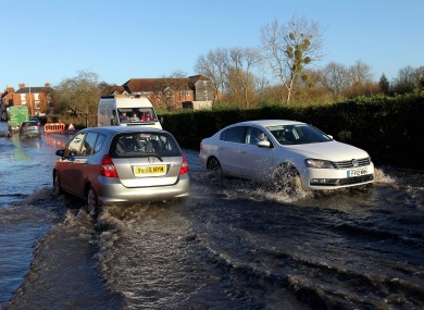 Cars make their way through flood water on Pershore High Street in Pershore, Worcestershire, as south-west Britain comes to terms with severe storms and flooding.
