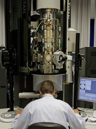 r Markus Boese at the controls of a transmission electron microscope in the Crann lab.