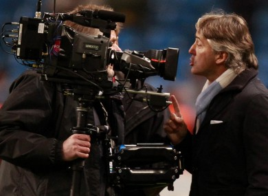 Manchester City manager Roberto Mancini argues with a cameraman last night.