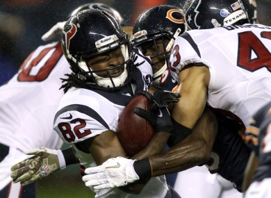 Houston Texans wide receiver Keshawn Martin (82) is tackled by Chicago Bears defensive backs.