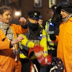 Gardaí stop Irish anti-war protesters burning an American flag (Pic: Laura Hutton/Photocall Ireland).