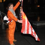 Irish anti war protesters burn an American flag as they are stopped from marching to Dublin Castle (Pic: Laura Hutton/Photocall Ireland)