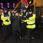 Irish anti war protesters scuffle with Gardaí as they are stopped from marching to Dublin Castle to protest (Pic: Laura Hutton/Photocall Ireland).