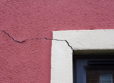 Cracks in the wall of a house affected by pyrite damage.