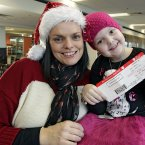 Pictured before boarding the Aer Lingus Regional Santa Express, Louise Shorthall (7) from Clondalkin, Dublin, with her mother, Tracey.