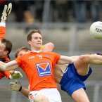 Collision time in the Hyde. On home soil Roscommon claim a famous win over Armagh with the Orchard County duo of Philip McEvoy and Finian Moriarty here challenging Roscommon's Niall Daly. (INPHO/James Crombie).