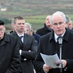 Munster Council chairman Sean Walsh delivers the graveside oration as Páidí's nephew Tomás Ó Sé watches on.
