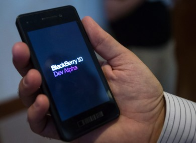 An attendee at the Blackberry 10 Jam World Tour holds one of the company's DevAlpha devices.