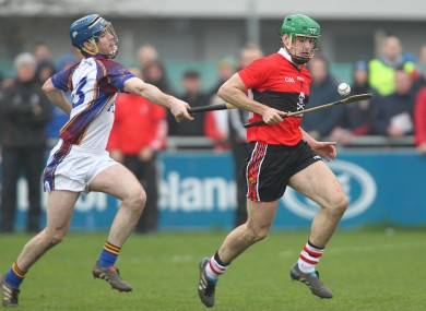 UL's Joe Gallagher and UCC's William Egan in action.