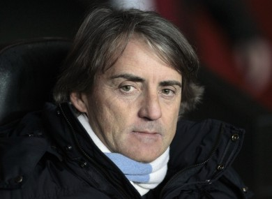 Manchester City's manager Roberto Mancini looks on from the dugout before the start of their English Premier League soccer match against Southampton.
