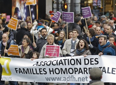 FILE: People demonstrate in support of the government project to legalize same-sex marriage and adoption for same-sex couples in Paris.