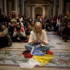 Some of the faithful pray inside the Metropolitan Cathedral before Pope Francis installation Mass in Buenos Aires, Argentina. (AP Photo/Natacha Pisarenko)