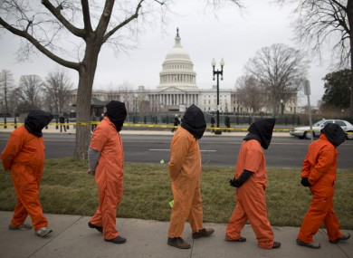 Demonstrators dressed as detainees march past the Capitol building during a rally against the US military detention facility in Guantanamo Bay in January.