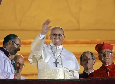Pope Francis waves to the crowd from the central balcony of St Peter's Basilica last night