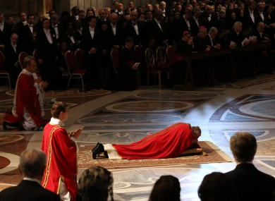 Pope Francis lies down in prayer during the mass at St Peter's Basilica today
