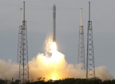 The Falcon 9 SpaceX rocket lifts off.