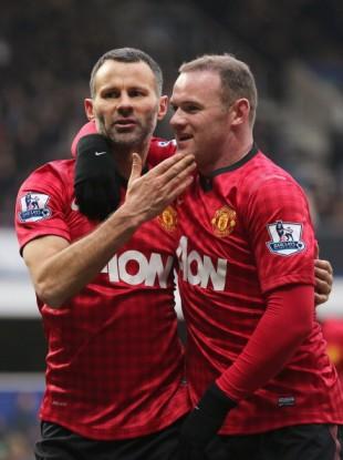 Ryan Giggs with team-mate Wayne Rooney.