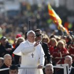 Pope Francis waves as he arrives in St. Peter's Square for his inauguration Mass at the Vatican, Tuesday, March 19, 2013. (AP Photo/Michael Sohn)