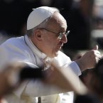 Pope Francis gives the thumbs up to the crowd. (AP Photo/Gregorio Borgia)