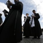 Priests pray during the Mass for the inauguration of Pope Francis. (AP Photo/Alessandra Tarantino)