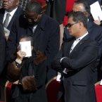 Ecuador's President Rafael Correa, right, attends Pope Francis' installation Mass. (AP Photo/Dmitry Lovetsky)