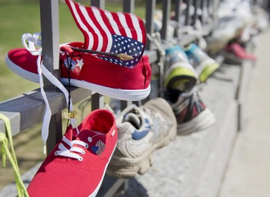 Running shoes, including one with an American flag, are tied to the gates of the American embassy in Ottawa after a march in solidarity with the Boston community in Ottawa, Canada.