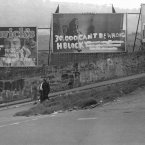 """On the edge of the graveyard were these early and famous-at-the-time 'interventions' on advertising hoardings. The one on the right says """"Bobby Sands MP is a martyr"""" The '30,000..' referred to the quite huge number of votes he got in the Westminster election."""