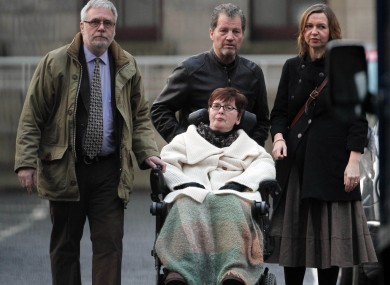 Marie Fleming at the High Court in Dublin in January with her partner Tom Curran (left), family friend Brian Gainey and daughter Corrina Moore.