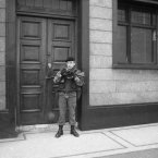 One of the earliest of these photos, on the 12th of July 1979, on the outskirts of Belfast. I was an 19-year-old art student following the annual 12th of July Orange parade and on the outskirts of the city found this young soldier with his own pocket camera taking pictures of the parade.