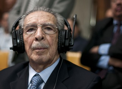 Guatemala's former dictator Jose Efrain Rios Montt wears headphones as he listens to the verdict in his genocide trial in Guatemala City