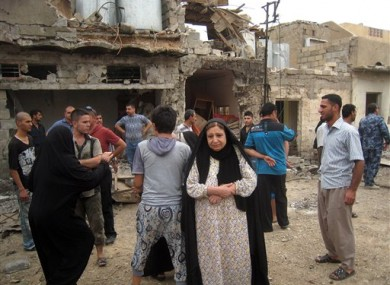 Residents react to a car bomb attack in Kirkuk, 180 miles north of Baghdad.