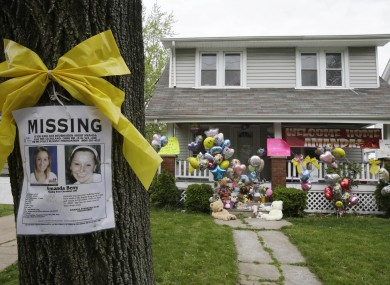 A missing poster outside the home of Amanda Berry today