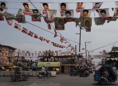 Election posters hang along a street in Manila, Philippines, ahead of elections last week.